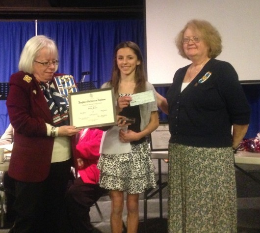 Holly Sudol receives her award certificate at the Daughters of the American Revolution luncheon in Mountlake Terrace.