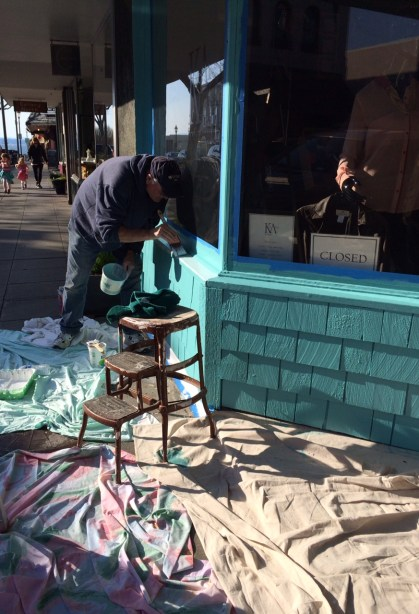 Workers putting some fresh colors on the  Kate Alise Boutique building on Main Street.