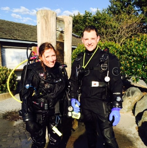 Julie Van Tosh took this photo of Katey, left, with friend TJ after Katey's first dive in the Edmonds Underwater Park Monday.