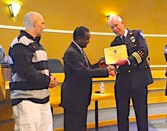 Citizens George Stathoulis and Amanual Debesay receive their awards from Edmonds Police Chief Al Compaan.
