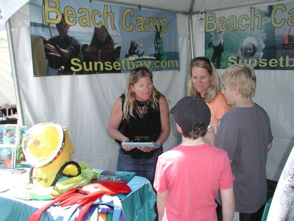 Booths offered a variety of products and services. Here, Annie Crawley, camp director for the City of Edmonds-sponsored Sunset Bay Beach Camp, talks to prospective campers.