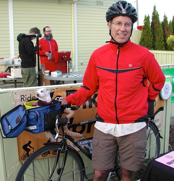 """Edmonds resident Doug Canfield takes the Sounder train to downtown Seattle, then pedals to his job at Mountaineer Books. His dog Besa tags long in a special basket on the handlebars on Mondays and Fridays, """"dog days"""" at the office."""