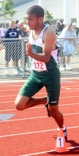 Edmonds-Woodway's Nate Gonzales leads off in the 400 relay.