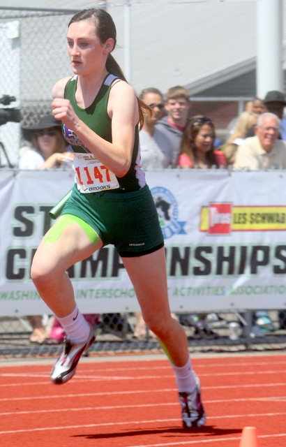 Edmonds-Woodway's Ella Spillane leads off in the 400 relay. Along with teammates Djenne Dickens, Fatou Jatta and Claire Popke, the Warriors took fourth in the finals.