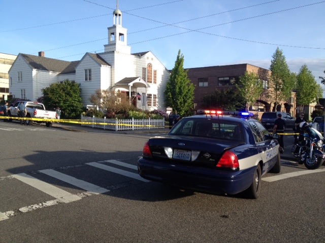 Police cars at the scene of the SUV-pedestrian accident in front of North Sound Church Tuesday.