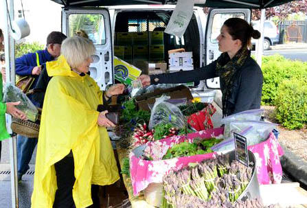 The Garden Market got underway on Saturday with more typical weather than the warm sun we had seen earlier this week: intermittent rain and breezy conditions.  Market-goers were treated to the first farm-fresh produce of the season.
