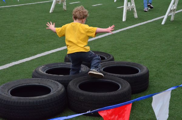 Participants in several age groups had the chance to race against the clock in an obstacle course that began with a series of tires.