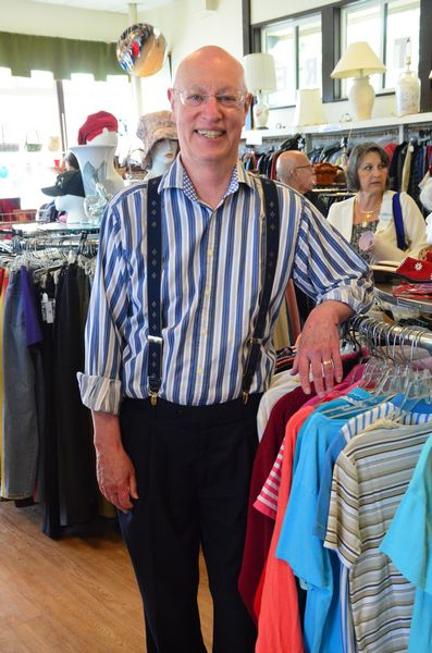 "Senior Center Director Farrell Fleming, a self-confessed thrift store fashionista, shows off his snazzy shirt and suspenders, both recent purchases from the Senior Center store. ""This may not be the biggest store around, but we've got the best stuff,"" he said."
