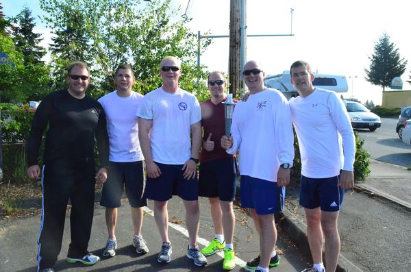 The Lynnwood runners pause before handing off the torch to the Edmonds team.  L to R Cmdr. Wes Deppan, Officer Aaron Surchet, Officer Andrew Reed, Recruit Michael Beckstead, Officer Matt Keller, Cmdr. Jim Nelson.