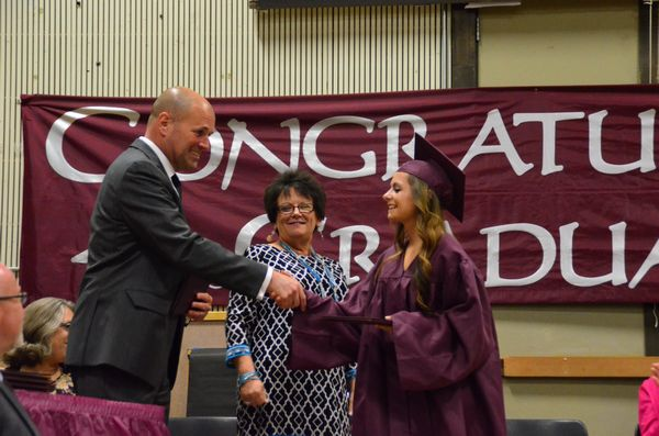 Dr. Nick Brossoit, Edmonds School District Superintendent, assisted in handing out diplomas.  Here he presents a diploma to Kallah Lynea Hill.