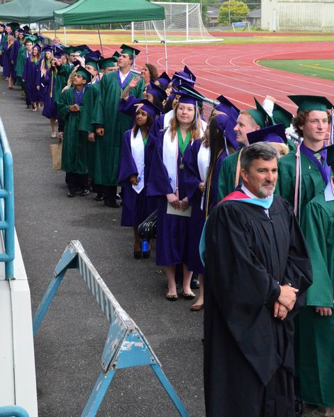 The EWHS Class of 2014 enters the stadium, led by Assistant Principal Geoff Bennett.