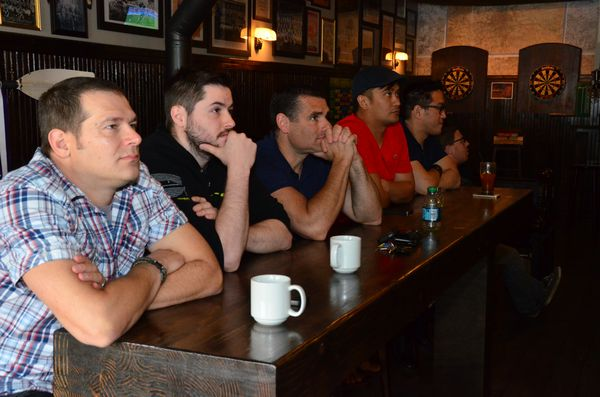 The crowd at the Churchkey Pub watch intently as the second half action unfolds on multiple big screen TV's.  By the second half many had traded in their coffee for adult beverages.