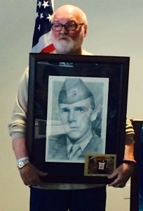 "The Rotary Club of Edmonds ""Noon Club"" was honored to have Michael Reagan speak at the Tuesday, July 1 meeting.  Reagan is seen holding a portrait that he drew of Vincent Santinello as part of his Fallen Heroes Portrait Project. Vincent became Michael's  inspiration.  Vincent died in Michael's  arms when Michael was only 19 and serving in Vietnam.  Vincent's last word to  Michael were ""I just want to go home"".  Michael was able to present this portrait to members of Vincent's family .   Michael is an Edmonds Resident and a Vietnam Vet who  has drawn 3500 portraits of Fallen Heroes.  This is his passion and he draws them for free and presents them to the families.  It takes him about 5 hours to draw one portrait.   For more information check out this video which was presented this past memorial day by KingTV http://www.king5.com/news/local/Artists-portrait-brings-fallen-veteran-home-260710571.html"
