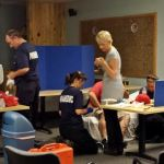 Rich Campbell, MD of Snohomish County Fire District 1 and Erica White, ARNP of Three Rivers Hospital lead their medical team in the MASH-style emergency room set up in Twisp during the wildfire.