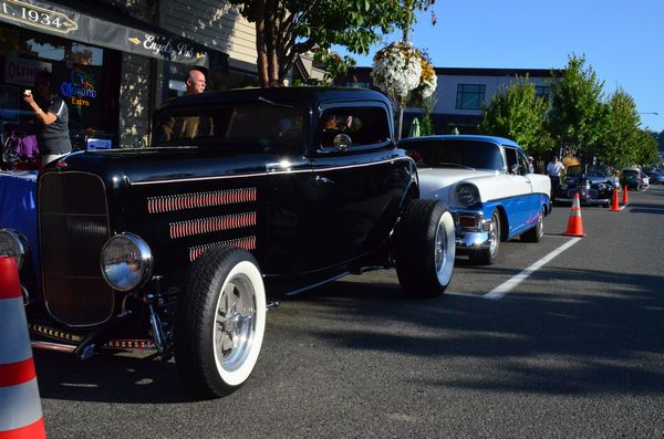 Classic autos line up in front of Engel's Pub Thursday night.