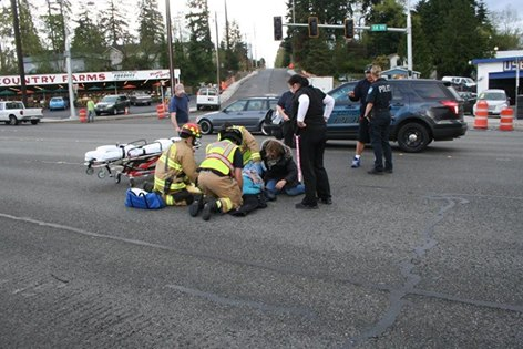a photo from the Hit and Run collision scene where the 88 year old woman was hit. That's her on the ground being attended to by the Fire Department. Anyone with info, please call or email us: EPDTips@edmondswa.gov