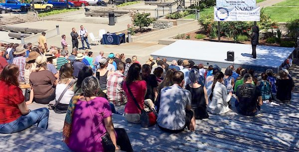 A small crowd gathered in vigil outside the Snohomish County Courthouse today over the deaths this past week of