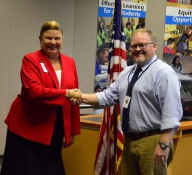 Superintendent Dr. Kris McDuffy greets Mark Roschy, the District's new Director of Classified Staff.