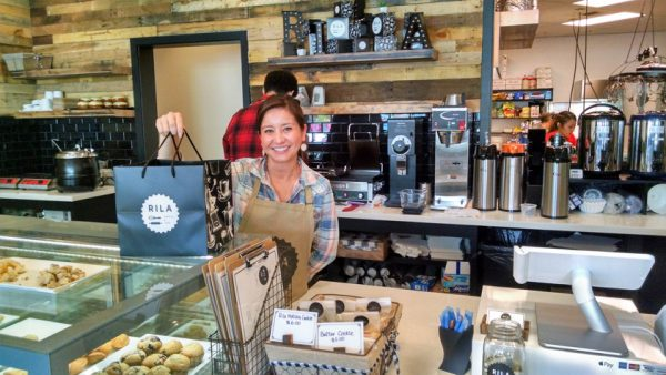 Barista Deb Harden packs up pastry to go at newly-opened Rila, a bakery cafe at 196th and 76th in Lynnwood