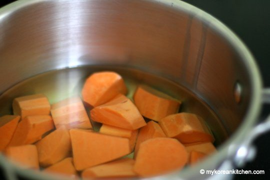 Sweet Potato and vegetable oil in a pot