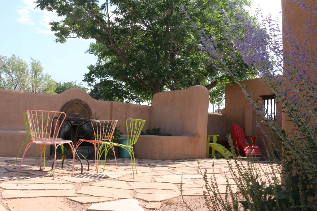 Outdoor New Mexico living space created from what was once a catch all storage area.