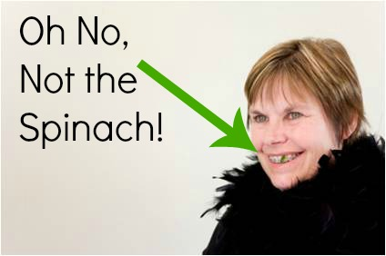 spinach in teeth caption