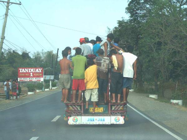 We follow a well-loaded jeepney back to Iloilo City