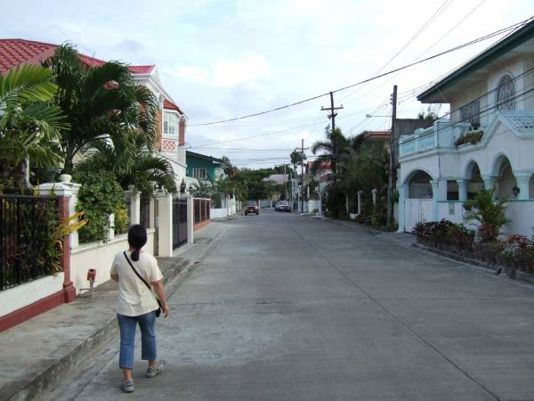 """""""Main Street"""" Southville Subdivision, Iloilo Iloilo City, Panay Island, Philippines  In December 2006 we looked at a large four bedroom house here. The price was P 9M. We looked at it again in August 2007. The price, fully furnished, was P 7M."""