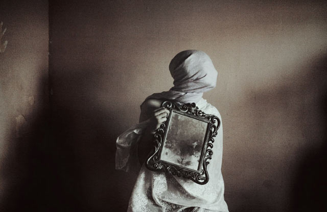 Conceptual portrait photography with a picture frame