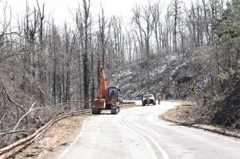 Arkansas State Highway crews worked last week clearing debris from the Talimena Scenic Byway as yet another winter storm brought significant ice accumulation and broke limbs and trees across the highway. This year's hard winter has had a devastating impact on the forest lining the drive but the views from Arkansas' second highest peak are still breathtaking.