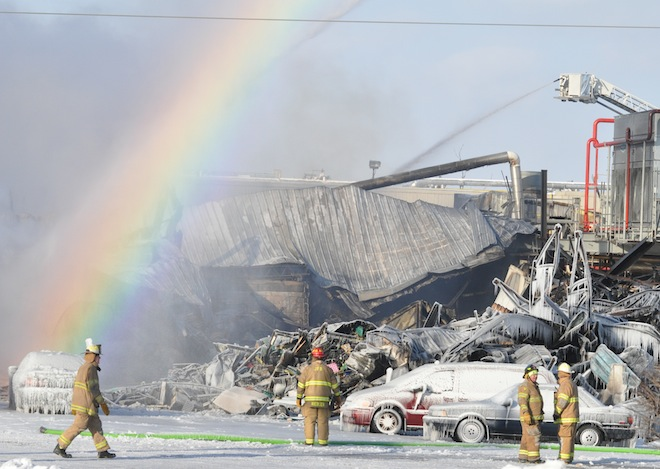 A rainbow appears over Echo Lake Foods Thursday morning as firefighters continue to spray water on the food processing plan destroyed by a blaze that began Wednesday evening (Photo by Ed Nadolski)