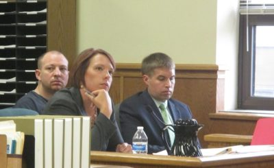 Andrew Obregon sits behind Kristyne Watson and Carl Johnson, both public defenders, in a motion hearing held in Kenosha County Circuit Court Friday. (Photo by Jason Arndt)