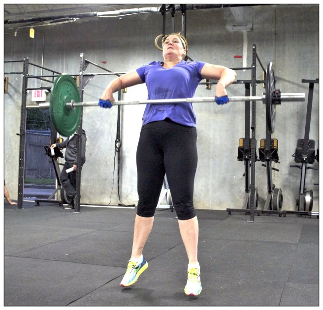 Crossfit Masters Level Competitor, Cathy Lawdanski, performing the Snath