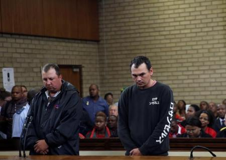 Two white South Africans charged after forcing black man into coffin