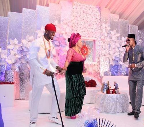 image of an igbo man with wife during their igbo traditional wedding