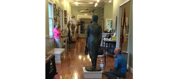 Sculptor John Steele Davis applies finishing touches to Lena Grove, at the Union County Heritage Museum.