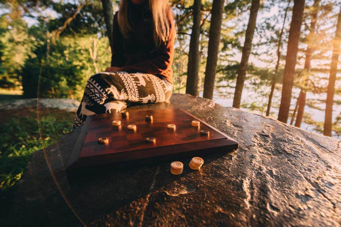 The voyageurs of old played a game similar to checkers, so we did the same from Woodenfrog campground by Kabetogama Lake