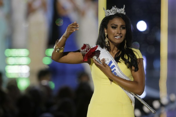 "Miss ""America"" trying to pose like the Statue of Liberty to throw off suspicions of Muslim terrorist activity."