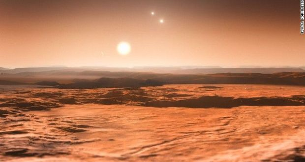artist impression shows the view from the exoplanet Gliese 667Cd looking towards the planet