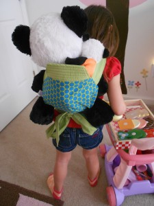 Sugarcone Shoppe Mei Tai Doll Carrier - Stuffed Panda worn by 3 year old Marcella