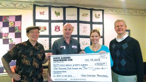 Pictured L-R: Dolphe, Todd, Jessica, and Daryl. NAVWC makes $1,500 donation to Crisis Services.