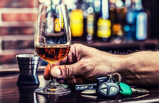 Cognac or brandy hand man the keys to the car