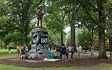 Students protest at the Silent Sam statue. Photo credit Martin Kraft, Wikimedia Commons