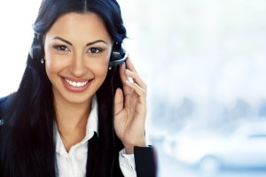Female customer service operator with headset and smiling