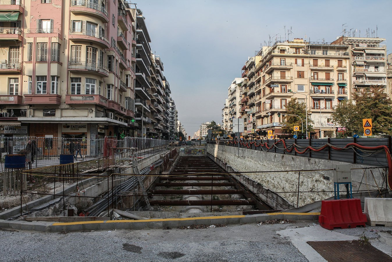 A gaping hole left by the aborted Metro project, like an urban wound, has disfigured the city aesthetically and burdened it with additional traffic. For locals, it serves as a constant reminder, not only of the Greek state's ineffectiveness, but also of the paralysis that the entire country has suffered since the onset of the crisis.