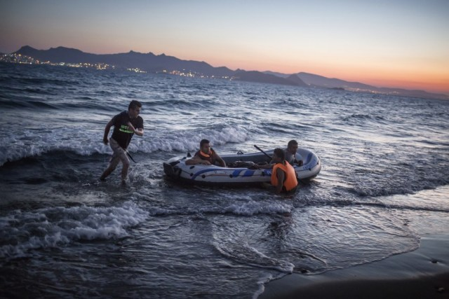 Migrants raft on the shore in Kos, Greece