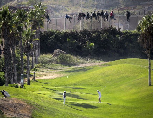 refugees scale fence of golf course in the Spanish enclave at Melilla, Africa