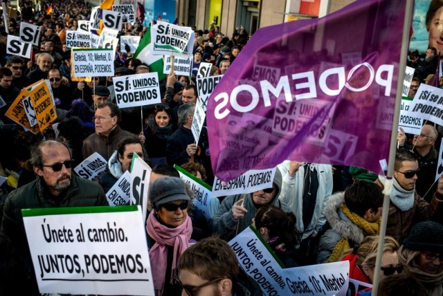 Podemos supporters holding banners at political rally in Madrid