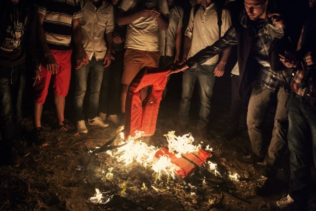 Refugees burn their life vests in Greece