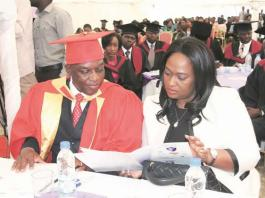 Police Commissioner-General Augustine Chihuri goes through the programme with his wife Isabel Chihuri after graduating with a Doctor of Philosophy Degree at Mt Camel Institute of Business Intelligence in Harare on Saturday